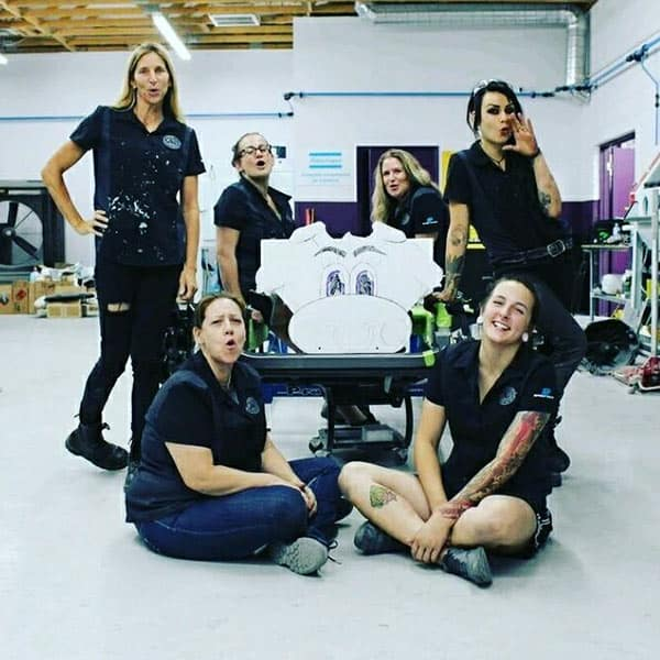 All Girls Garage cast looking lovely in black dress