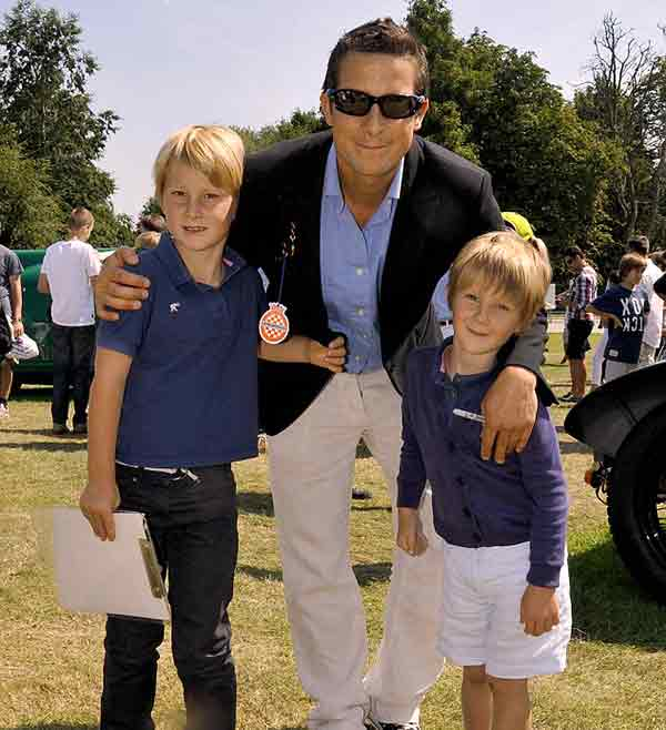 Bear Grylls looks very happy with his sons