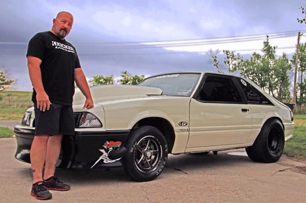 Chuck Seitsinger standing in front of his car at Street Outlaws