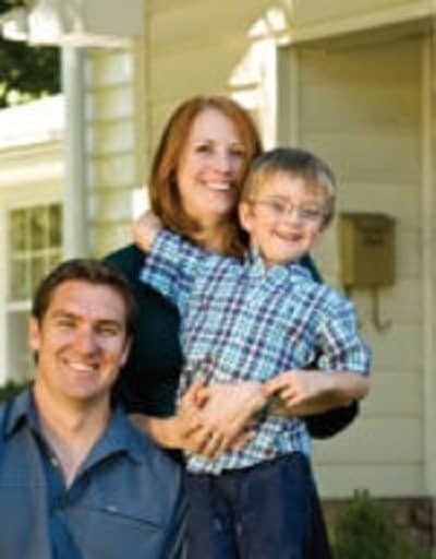 Barnwood Builders Mark Bowe with his wife Cindy Bowe and son Atticus.