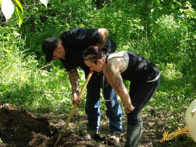 Chico and wife Cassondra working in tv show Moonshiners