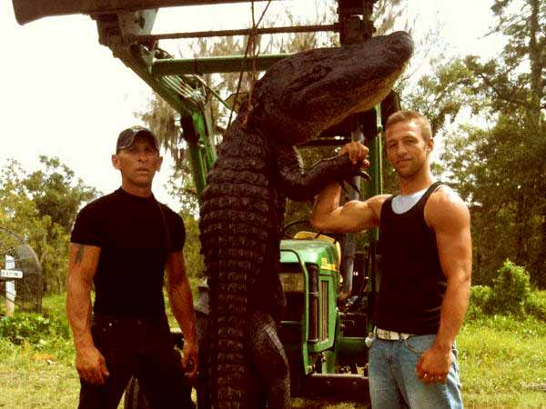Image of R.J Molinere (left) and hi son Jay Paul Show off an alligator they caught