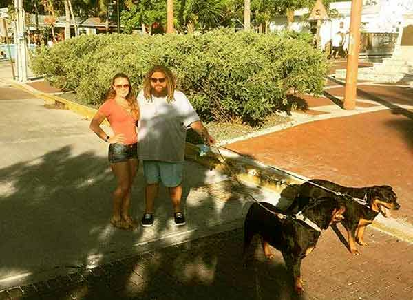 Image of TJ Ott with his wife Kristina Doellman and with their pets