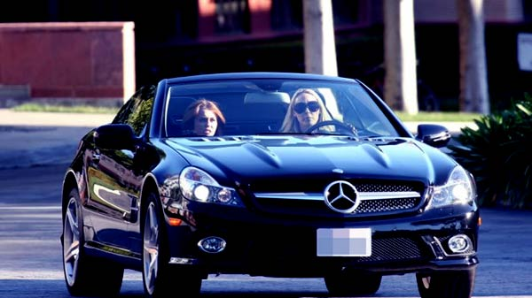 Image of Lauren Conrad black colored Mercedes-Benz SL550 car
