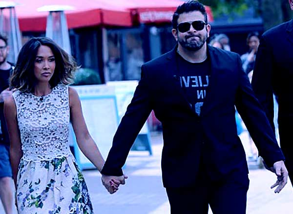 Image of Adam Richman with Myleene Klass, holding hands after leaving the TV station after an interview