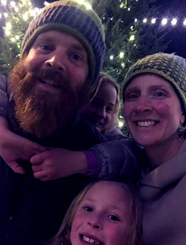 Image of Chase Morrill with his wife Sarah Morrill and with their kids