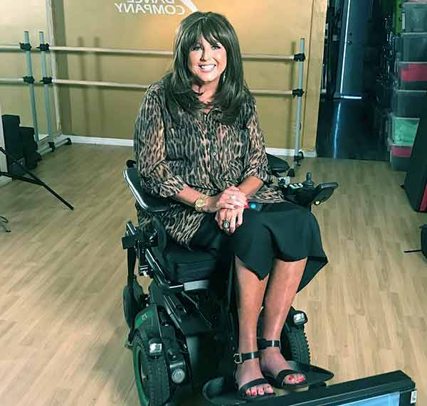Image of Abby Lee Miller in wheelchair due to non-Hodgkin's lymphoma blood cancer