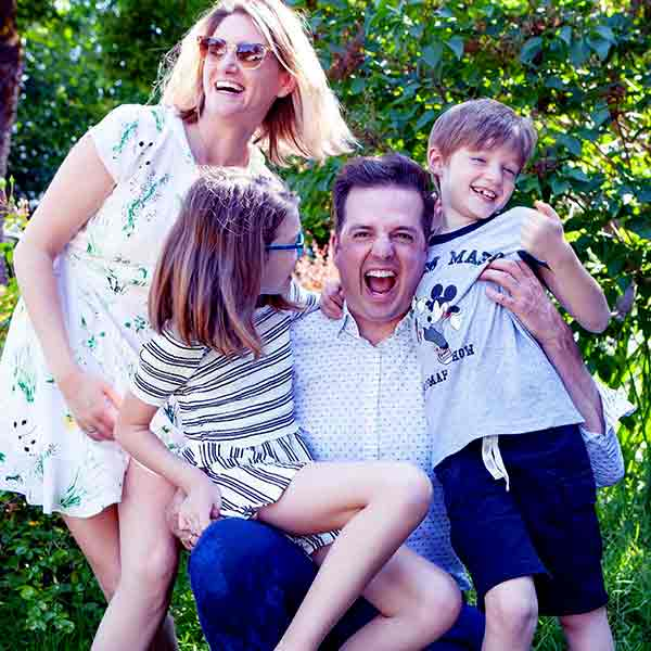 Image of Todd Talbot with his wife Rebecca Codling and with their kids