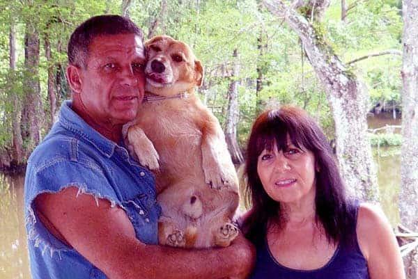 Image of Shelby Stanga with his wife Donna Stanga and a dog