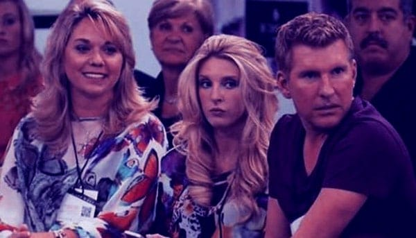 Image of Lindsie Chrisley with her parents father (Todd Chrisley) and mother (Julie Chrisley)