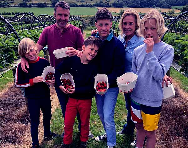 Image of Sarah Beeny with her husband Graham Swift and with their kids