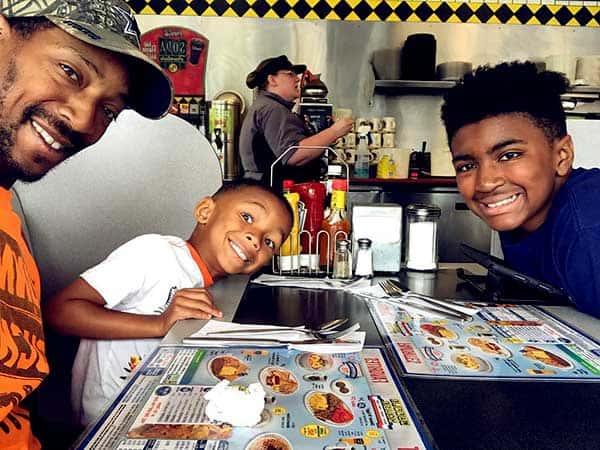 Image of Christopher Morgan with his kids Quincy Xavier Morgan and Sebastian Alexander Morgan