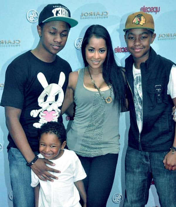 Image of Lisa Wu with her kids Justin Sweat, Jordan Sweat and Edgerton Hartwell, Jr.