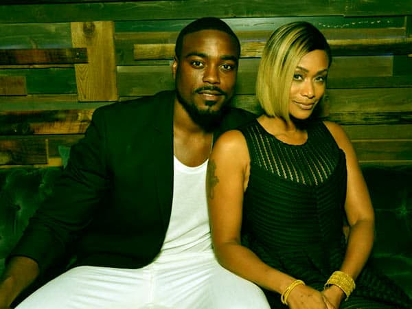 Image of Tami Roman with her husband Reggie Youngblood.