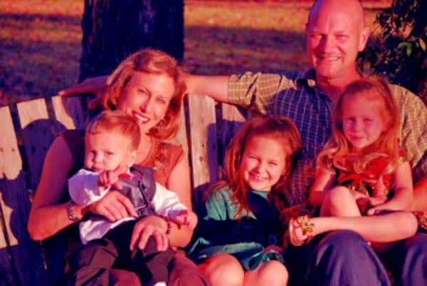 Image of Dr. Susan Kelleher with her husband Greg Martin and with their kids