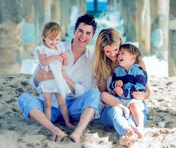 Image of Dr. Will Kirby with his wife Erin Brodie and with their kids