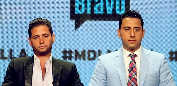 Image of TV personalities Josh Flagg and Josh Altman speak onstage at the 'Million Dollar Listing