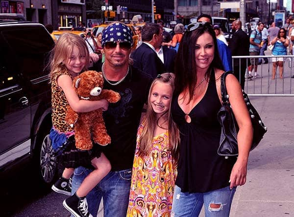 Image of Kristi Gibson with her husband Bret Michaels and with their daughters