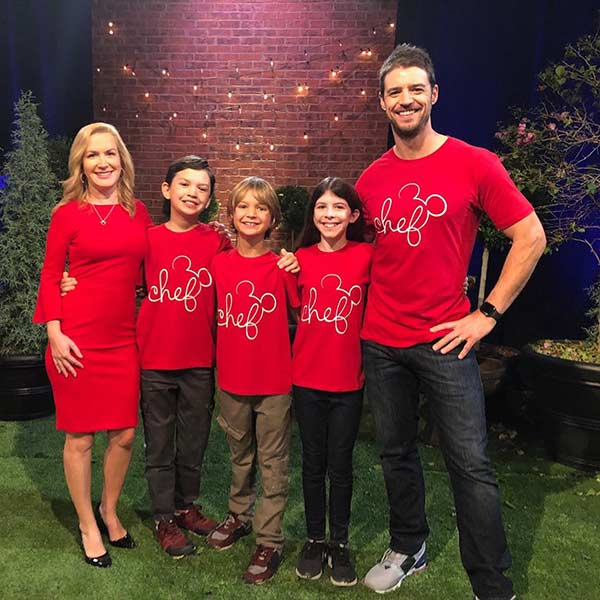 Image of Angela Kinsey with her husband Joshua Snyder along with their kids
