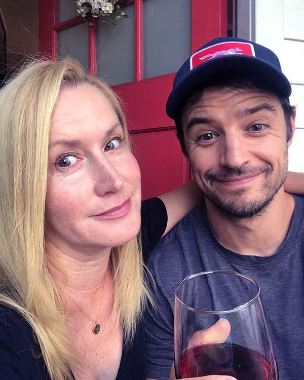 Image of Angela Kinsey with her husband Joshua Snyder
